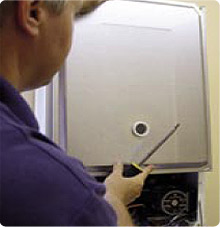 engineer fixing boiler
